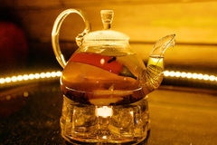 Glass teapot with hot tea on the fruit Stock Photography