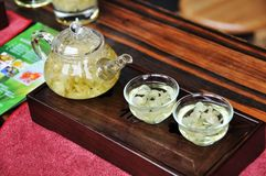 Glass teapot with jasmine tea Royalty Free Stock Photos