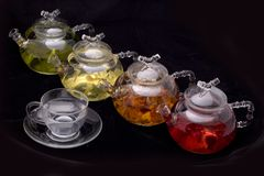 Glass teapot and mug. On black background, drink, hot, transparent, water, beverage, ceremony, closeup, food, fresh, health, healthy, herb, herbal, leaf stock photo