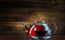 Glass teapot and mug Stock Photo