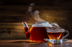 Glass teapot and mug Stock Images