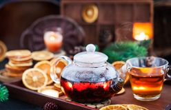Glass Teapot Of Hot Black Tea On Cozy Background With Dried Oran Royalty Free Stock Photo