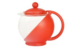 Glass teapot in red enclosure. Against white background Stock Photo