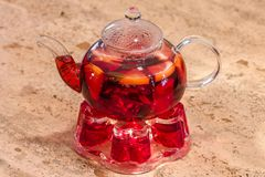 Glass teapot with tea royalty free stock photography