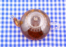 Glass teapot on tableclot Stock Images