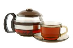 Glass teapot with tea and cup isolated Royalty Free Stock Photography
