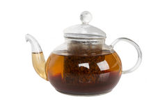Glass teapot with tea on white background Royalty Free Stock Photo