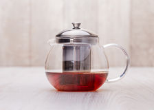 The glass teapot tea, on woodwn table Royalty Free Stock Photos