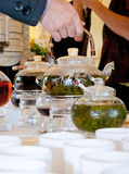 Glass teapots with fresh tea Royalty Free Stock Images