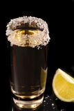 Glass of tequila with lime Stock Image