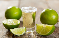 Glass of tequila with lime Stock Photos