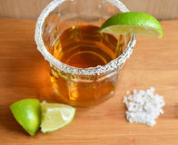 Glass of Tequila with limes and salt Royalty Free Stock Photo