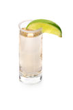 A glass with tequila, served with salt and sappy slice of lime, fervent Mexican drinks  on a white background. Hot Mexican tequila in a shot glass with salt and Stock Images