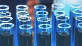 Glass test tubes with blood samples. Close-up panning with stylish blue color lighting effect. stock video