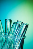Glass test tubes together on the blue background Royalty Free Stock Image
