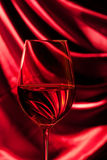 Glass on a thin stalk filled with wine Stock Photography