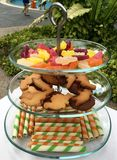 Glass three layer cake stand for outdoor pool party Stock Photos