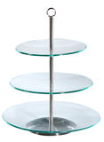 Glass three - level cake stand. Isolated on white Stock Image