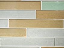 Glass tile. Backsplash in kitchen form random rows on wall Royalty Free Stock Photos