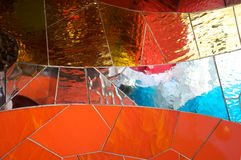 Glass and tile mosaic. Multicolored glass and tile mosaic creating abstract shapes Royalty Free Stock Photography