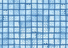 Glass tile wall. Transparent blue glass tile window wall grid background Royalty Free Stock Photo