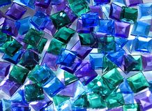 Glass tiles. Blue, green and violet glass tiles laying at glass stock photography