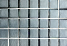 Glass tiles. A wall made of glass tiles Stock Images
