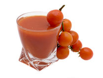 Glass of tomato juice. Tomato juice and tomatoes on a white background Royalty Free Stock Photos