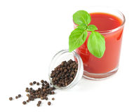 Glass of tomato juice with basil leaves and bowl with black pepper Royalty Free Stock Images