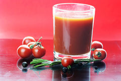 Glass of tomato juice drops Royalty Free Stock Images
