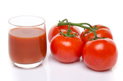 Glass of tomato juice with fresh tomatoes Stock Photo
