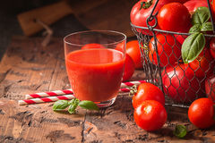 Glass of tomato juice Stock Images