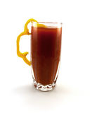Glass of tomato juice with a pepper segment Royalty Free Stock Photo