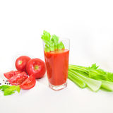 Glass of tomato juice with selery, pepper and tomatoes Royalty Free Stock Photo