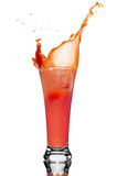 Glass of tomato juice. A slice of tomato drops into a glass of juice, squirt of tomato juice Stock Photo
