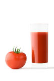 Glass of tomato juice and tomato. High glass glass with tomato juice and tomato on light background Stock Photos