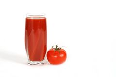 Glass of tomato juice with tomato Royalty Free Stock Photos