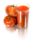 The glass of tomato juice and tomatoes. Isolated on white background Stock Photos