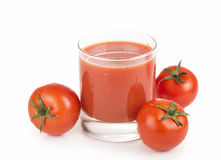 Glass of tomato juice and tomatoes Royalty Free Stock Photos