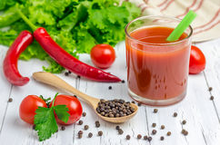 Glass of tomato juice and vegetables on background. Glass of tomato juice with vegetables on background Stock Images