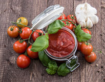 Glass with Tomato Sauce Stock Image