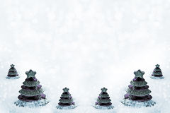 Glass toy Christmas tree in snow. Royalty Free Stock Photos