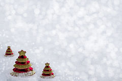 Glass toy Christmas tree in snow. Royalty Free Stock Photography
