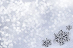 Glass toy snowflake on snow background. Royalty Free Stock Photo