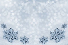 Glass toy snowflake on snow background. Stock Images