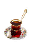 The glass of traditional Turkish tea with sugar and spoon Royalty Free Stock Image
