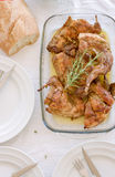 Glass trail of traditional baked rabbit with herbs Royalty Free Stock Images