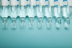 Glass transparent ampoules in a row, empty space for text stock photo