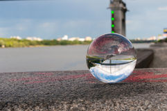 Glass transparent ball on bridge background and Stock Images