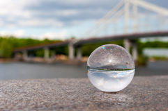 Glass transparent ball on bridge background and Stock Photos
